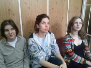 A photograph of Maria Alekhina, Nadezhda Tolokonnikova, & Ekaterina Samucevich
